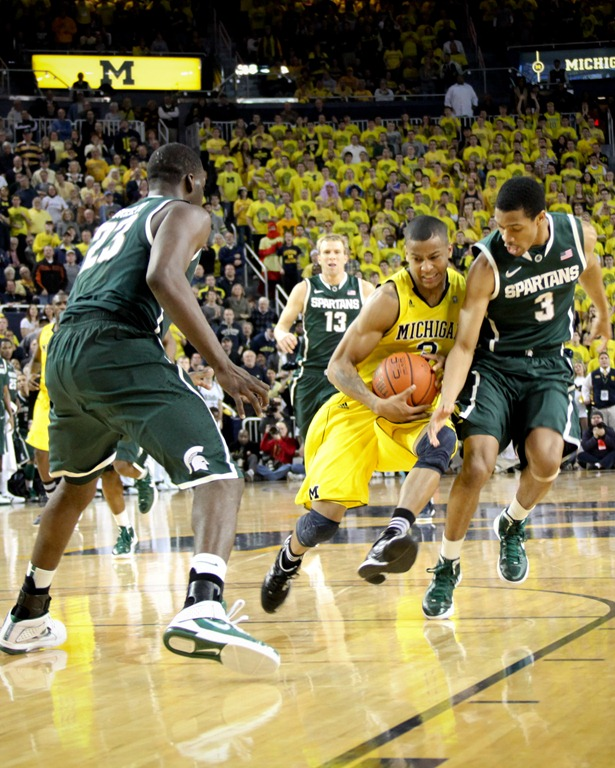 Burke drives for the deciding assist against Michigan State