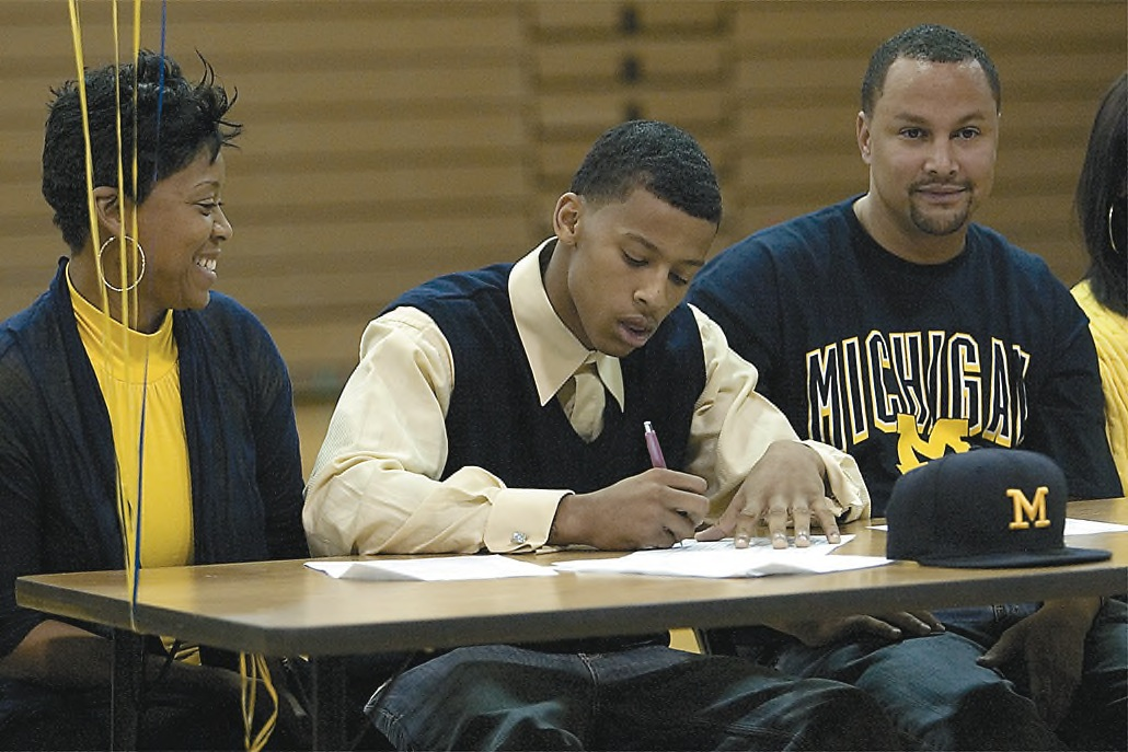 Trey Burke signs his letter of intent at Northland High School