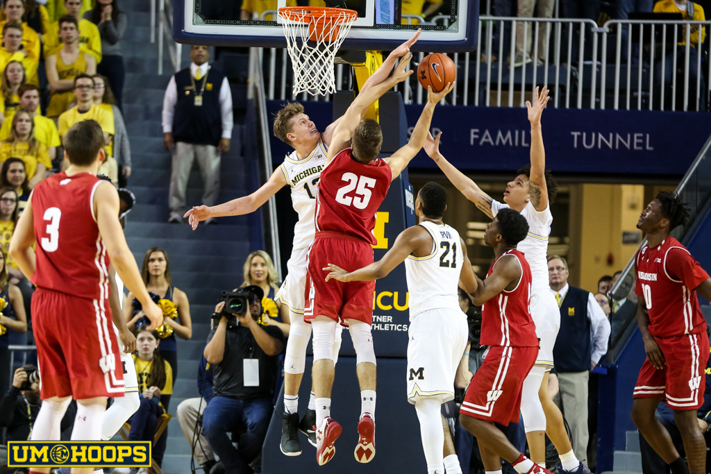 Michigan 64, Wisconsin 58-21